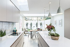 Installing a white modern kitchen to create light and space, London