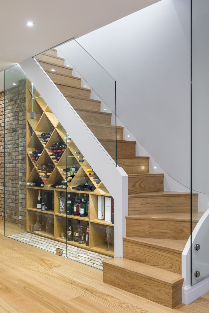 Staircase with custom made wine cellar